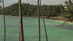 Stock Video Footage of The azure shore of the ocean near a tropical island with palm trees