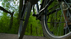 Cyclist cycling on forest path Stock Footage