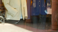 Blazers on mannequins at window display Stock Footage