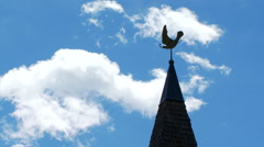 Weather vane on top of spire - stock footage