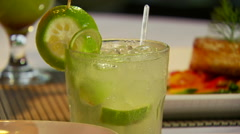 Mocktail and appetizer set on table - stock footage