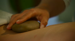 Woman getting hot stone massage at beauty spa Stock Footage
