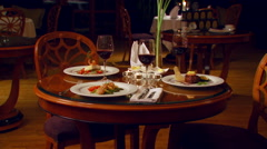 Delicious meals set on dining table Stock Footage