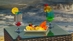 Mocktail and fruits set on table near seashore Stock Footage