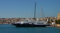 Yachts moored on harbor Stock Footage