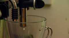 Coffee being brewed from espresso machine - stock footage