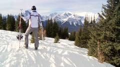 Skier on mountain slope - stock footage