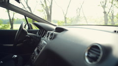 Pregnant woman sits in the car on the driver's seat and wear a safety belt Stock Footage