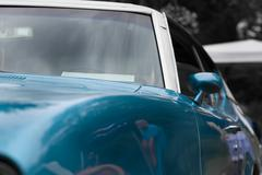 Wing mirror of a blue shiny classic vintage car Kuvituskuvat