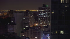 Brooklyn cityscape at night with Statue of Liberty in background 4k Stock Footage