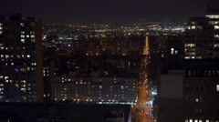 Brooklyn Bridge in background of city at night Stock Footage