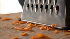 Vegan food carrot and grater Stock Footage