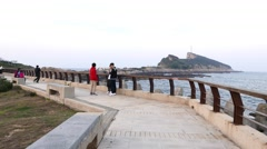 Public embankment against Yehliu Geopark cape, FPV move along - stock footage