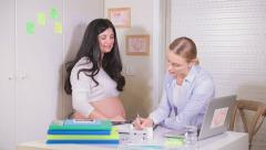 Pregnant woman visiting physician. Full HD Video Stock Footage