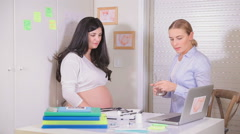 Pregnant girl at the doctor. Full HD Video Stock Footage