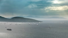 Sea scenery with boats sailing in a cloudy day with the sun rays bursting Stock Footage
