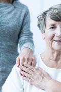 Stock Photo of Elderly female with positive attitude