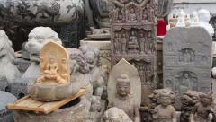 Chinese decorative sculptures of stone at a Panjiayuan Flea Market, Beijing Stock Footage