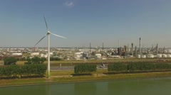 Aerials Botlek Europoort Rotterdam Slow rise with turning windmill Stock Footage