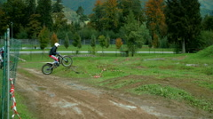 Two motorbikers are lifting the front wheels up and overcoming bumps Stock Footage