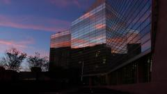 Pink Clouds Reflected in Office Building Windows Stock Footage