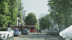 People cross the road, kind of car Stock Footage