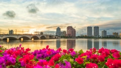 West Palm Beach Skyline with Flowers at Waterway Time Lapse Stock Footage