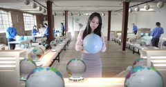 4K Manager in globe production factory checking quality of the products - stock footage