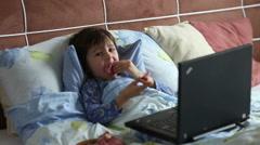 Stock Video Footage of Sick child boy lying in bed with a fever, resting at home