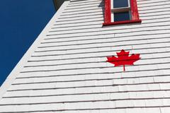 Stock Photo of Canadian emblem painted on roof, Seaport Lighthouse Museum, Prince Edward Island