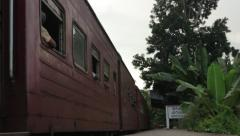 The train departs from the train station in the rain forest. Asia. Sri Lanka Stock Footage