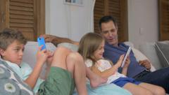 Father and kids spending time together in living room Stock Footage