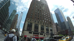 Traffic and buildings at Midtown Manhattan in NYC Stock Footage