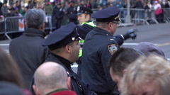 Police officers along fence line at Macys Parade 2015 4k Stock Footage