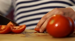 vegan food cutting tomatoes - stock footage