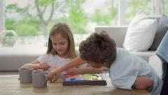 Children playing board game at home having fun together Stock Footage