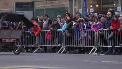 People gathered along fence line waiting for Macys parade to begin 4k Stock Footage