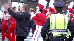 NYPD officer standing along side marching band in Macys Parade 4k Stock Footage