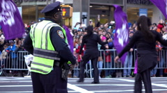 NYPD officer watches people in Macys Parade go by 4k Stock Footage