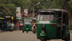 Tuk-tuk and other modes of transport on the road in Asia. Sri Lanka Stock Footage