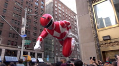 Red Power Ranger flying through buildings of New York City 4k Stock Footage