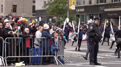 Police with crowd of people behind fence at Macys Parade 4k Stock Footage