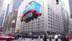 Thomas the Train balloon going through intersection in 2015 Macys Parade 4k Stock Footage