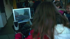 Children at the automobile event are being entertained with video games - stock footage