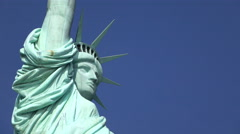 Face of Statue of Liberty on blue sky 4k - stock footage