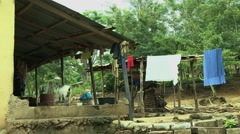 GHANA CLOTHES HANGING NEXT TO VILLAGE HOME Stock Footage
