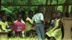 GHANA MEDIUM ON YOUNG PAKRO STUDENTS IN OUTDOOR CLASSROOM - stock footage