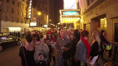 Crowded 45th Street and theaters in Manhattan NYC at night Stock Footage
