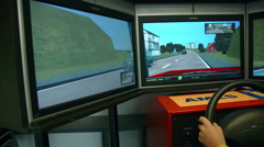 Young boy playing video games at the automobile event Stock Footage