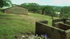 GHANA WIDE ON PAKRO SCHOOL KIDS RUNNING FROM OUTDOOR TOILET - stock footage